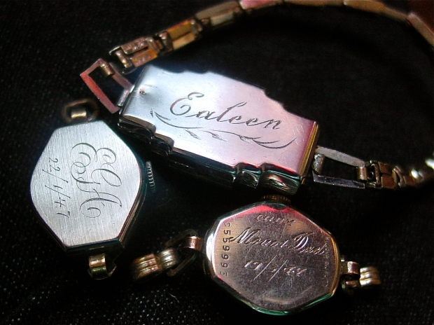 Three engraved and monogrammed watch cases