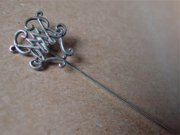 silver stickpin with cipher