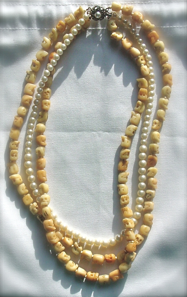 Faux pearl and carved bone skull multistrand necklace