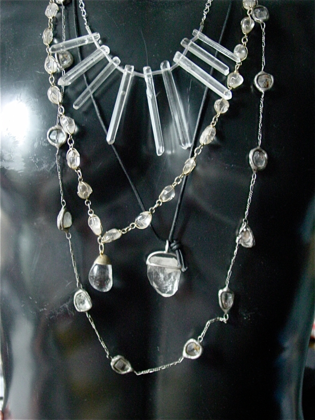 a colection of rock crystal necklaces