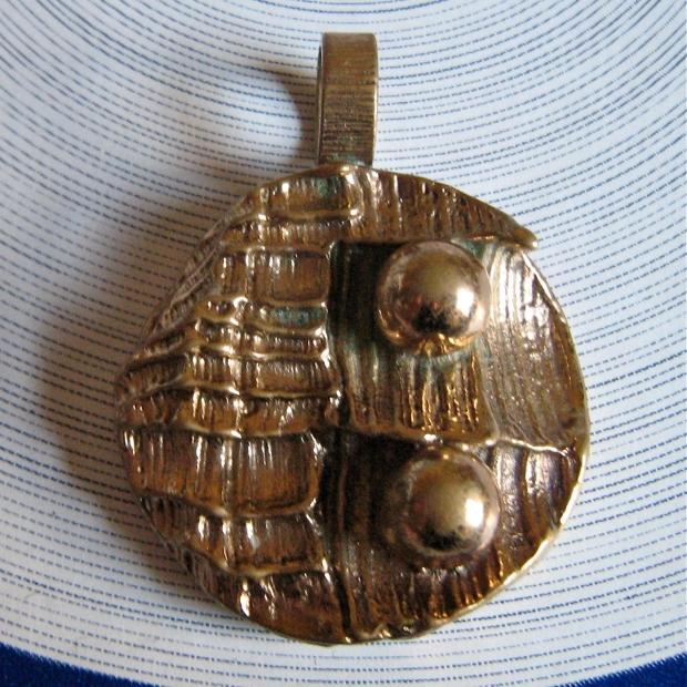 made in finland bronze pendant